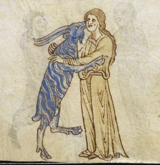 Женщина обнимает козу.